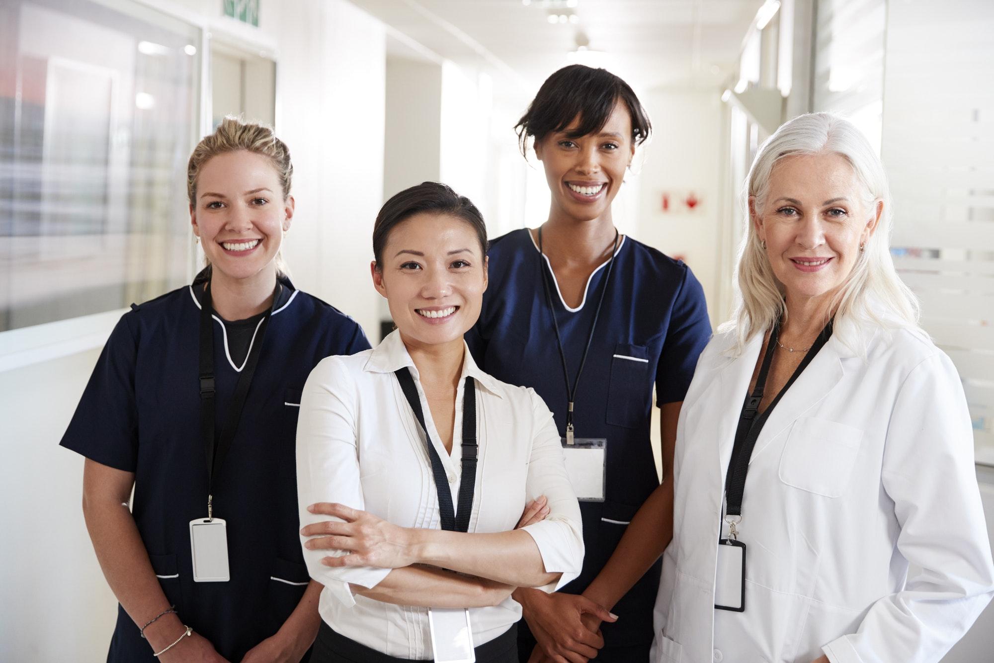 Portrait Of Female Medical Team Standing In Hospital Corridor